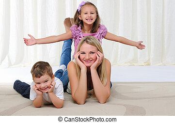 young mother, her daughter and son - A young mother, her...