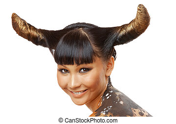 Cow style - Portrait of female with horns looking at camera