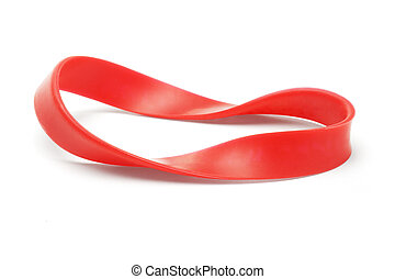 Twisted red rubber wrist band on white background