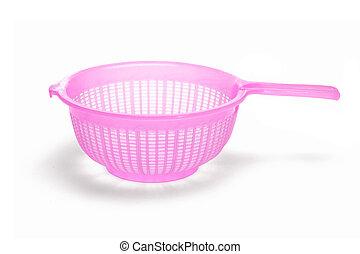 Plastic colander - Pink plastic kitchen sieve on white...