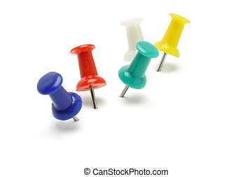 Colorful push pins arranged on white background