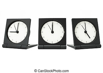 9 am to 5 pm - Desktop alarm clocks showing 9 am to 5 pm on...