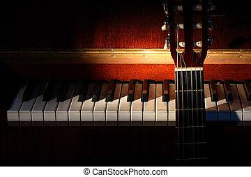Music Concept - Closeup of guitar standing near open piano...
