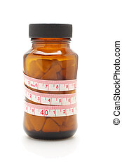 Tape measure and diet pills in glass bottle on white...