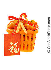 Gift basket of mandarin oranges and Chinese new year red packet on white background