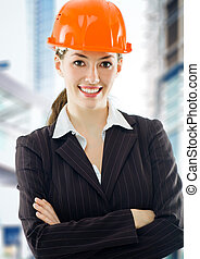architect - a beautiful young architect in a hardhat