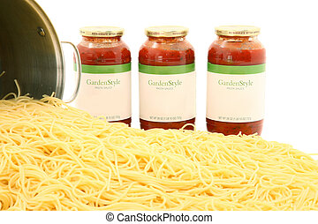 Pot of Spaghetti Noodles and Sauce Jars - Large pot of...