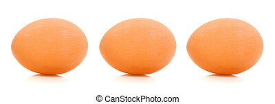 Brown Eggs - Three brown chicken eggs in a row over white