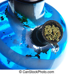 Bowl of Cannabis - Bowl of ground cannabis leaves in a water...