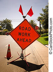 Road Work Ahead sign near a street corner