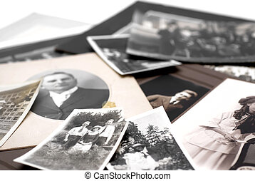 Family Photographs - Closeup of a pile of vintage family...