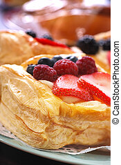 Pastries - Plates of assorted pastries with a variety of...