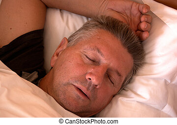 mature man sleeping - Mature man clothed and asleep in bed
