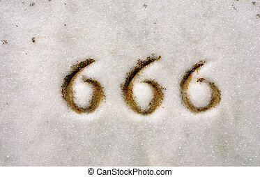 Triple Sixes 666 - Macro of numbers 666 engraved on granite...