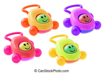 Colorful smiley baby rattle cars arranged on white...