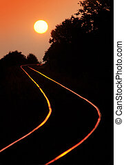 Railroad tracks at sunset - Curved railroad tracks in sunset...