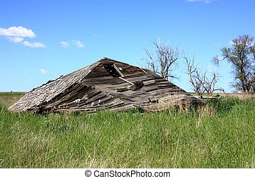 old collapsed barn.