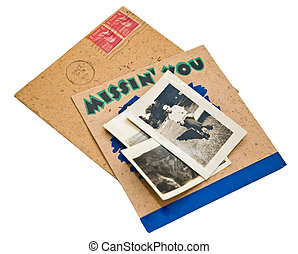 Old Card and Photos - Three old photographs on top of a...