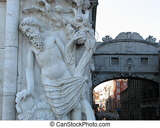 ancient statue near the Bridge of Sighs in Venice