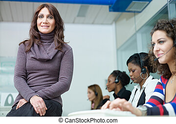 women working in call center - confident businesswoman with...