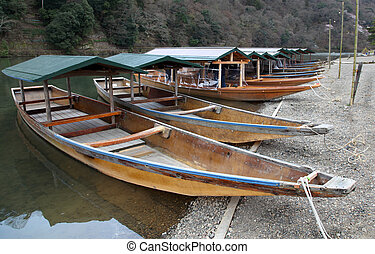 River boats for hire.  Arashiyama district in Kyoto Japan