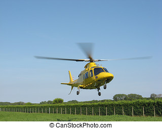 yellow emergency helicopter during take-off