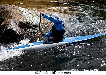 kayaker maneuvering at river treska ,in canyon Matka...
