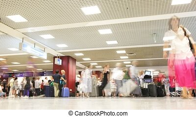 People with luggage in Leonardo da Vinci - Fiumicino airport.