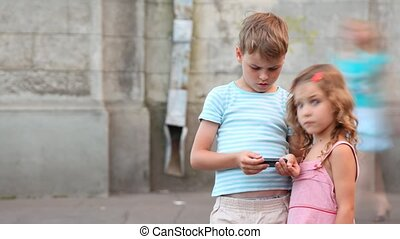 The boy plays at psp, the girl observes of it. - The boy...