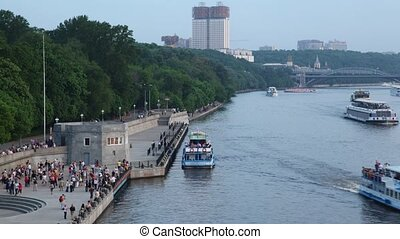 Ships leave and arrive to landing stage with people - MOSCOW...