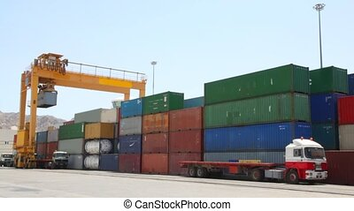 loading of containers with cargo to trucks in seaport