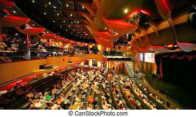 people sits in concert hall