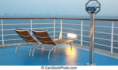 deck chairs and binocular on moving cruise ship