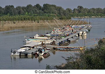 floating quay, po river - floating quay of harbour on a...