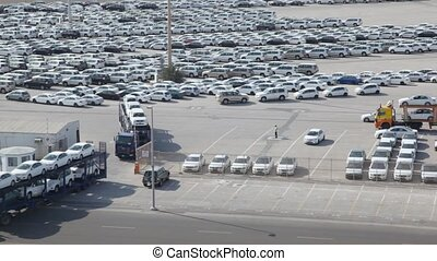 automobile transporters with new cars leaves parking