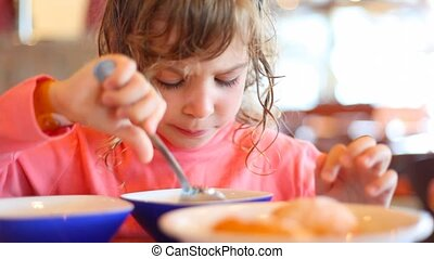 portrait of eating little girl