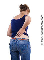 back pain - Female in blue shirt and jeans holding lower...