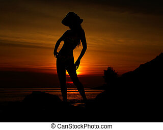 Sunset Woman - A colourful sunset image with a silhouette of...
