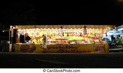 Stall with sweets in night street in Rome, Italy - ROME -...