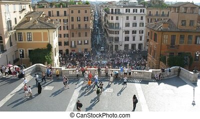 tourists are on Spanish Steps (Scalinata) in Rome, Italy.