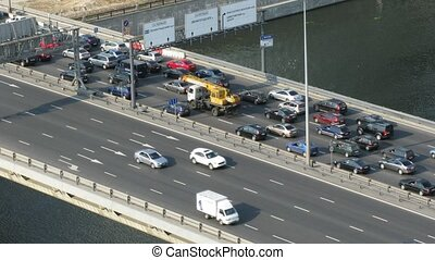 Cars moves on the bridge in sunny day in Moscow, Russia.