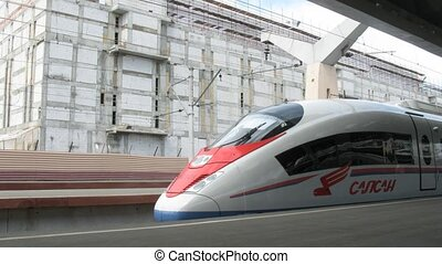 high-speed electric train Sapsan is at platform of train...