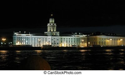 Kunstkamera and Palace Bridge on night river Neva in...