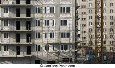 House building, builders build scaffolding
