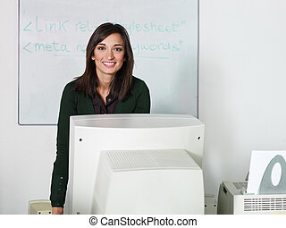 Teacher in computer class - Portrait of caucasian female...