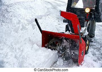Snowblowing - Winter season fun: Man removing snowstorm...