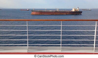 view on barges in sea from moving cruise ship