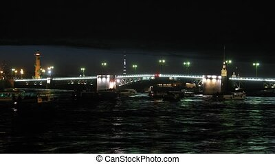 Drawbridge in St-Petersburg at night, on river ships float -...