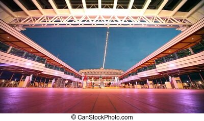 Tourists and workers on deck of cruise ship in night sea in...