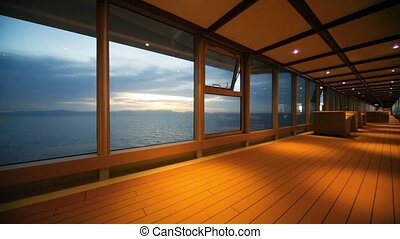 indoor deck of cruise ship moving in night ocean